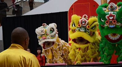 Sifu, or master, Ash McKenzie looks on as his students perform the southern style lion dance Sunday on the eve of the Year of the Dragon. The southern style is usually only performed on New Year's Day but McKenzie's school made an exception for the Scarborough Town Centre celebration.