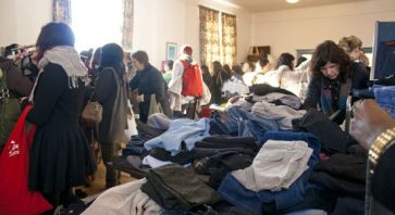 Dozens of participants dig through piles of donated clothing on Jan. 21 at Queen Street East Presbyterian Church looking for that special vintage find at this year's first Uber-SWAP — a vintage and used clothing event benefiting charity that happens four times a year.