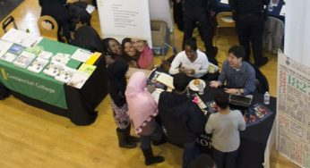A group gathers at the U of T table to get post-secondary school updates.