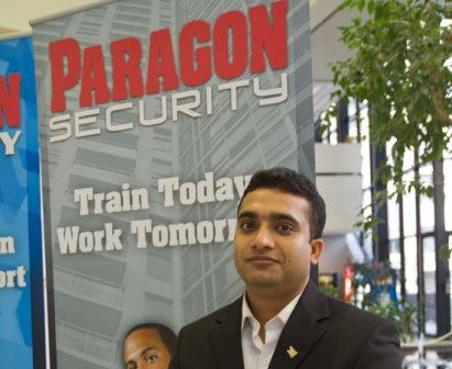 Sibsankar Baidya stands proudly beside the Paragon Security booth that was constantly busy.