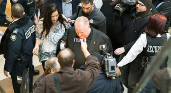 Mayor Rob Ford, surrounded by media and security, takes a stroll through Scarborough Town Centre Saturday for his weight-loss challenge.