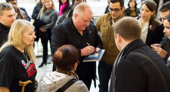 Mayor Rob Ford signs a picture for Elena Pablo Saturday at Scarborough Town Centre.