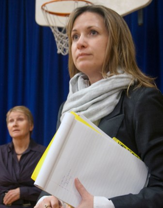Coun. Michelle Berardinetti (right) and Patricia Mueller listen intently to a resident's concern.