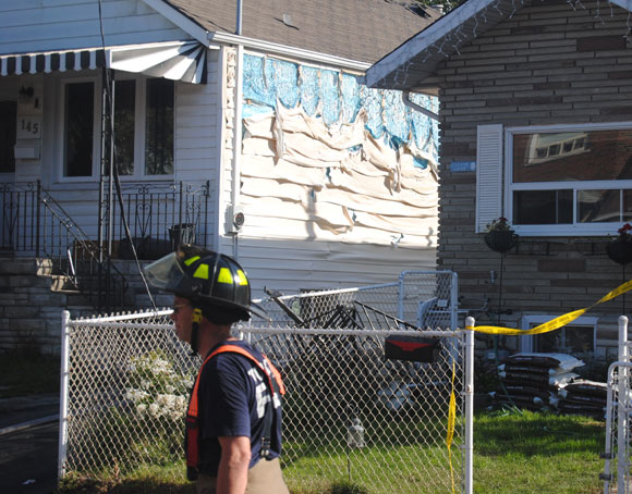 Nearby houses were not spared as the fire spread. The blaze melted the siding on a number of surrounding houses.