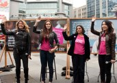 Sophie Grégoire (left), Alyssa Reid, Karen Craggs-Milne and Plan Canada youth ambassador Jennifer Dong raise their hands to show their support for girls right to education.