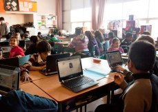 After using the laptops for one week, their teacher Lee Wong said the children are more engaged during English class.
