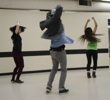 Patrick Pil (centre), 19, teaches Megan MacDonald (left), 20, and Faye Hue,19, the choreography for the competition.