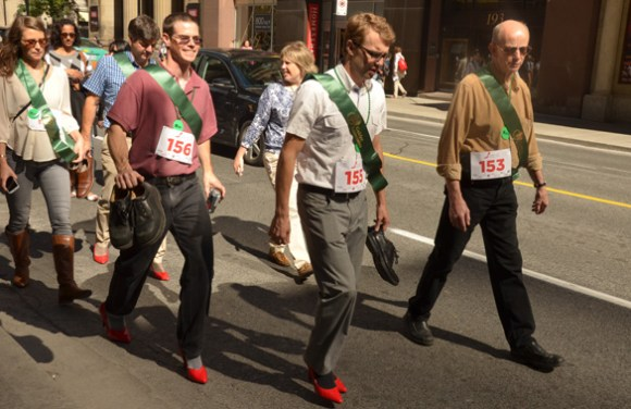 The Walk a Mile in Her Shoes campaign hit Yonge Street on Friday afternoon.