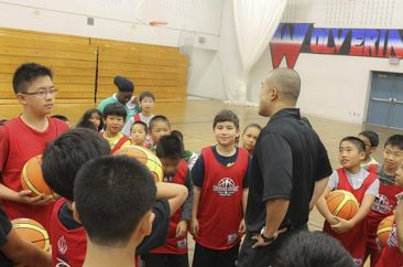 Ron Yeung calls the kids in for a pep talk.
