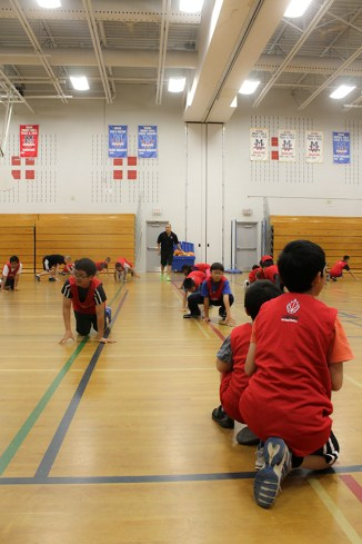 Some brief warm-ups get the kids ready for practicing the fundamentals.