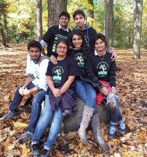 Students from Centennial College and other volunteers pose wearing their cleanup shirts at Highland Creek during the Oct. 20 Great Canadian Shoreline Cleanup event.