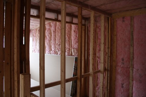 The upstairs room with fresh insulation and new support beams. The complexes are currently having insulation placed, which were never there before.