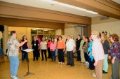After rehearsing most of the songs in their repertoire, the members of the Scarborough Sweet Adelines Chorus continue to work out their vocal chords.