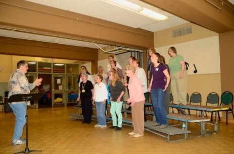 Dianne Clare, left, directs the Scarborough Sweet Adelines Chorus at St. Paul's L'Amoreaux Church.