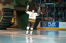 Defenseman Dylan Blujus coming out of the tunnel saluting the crowd.