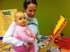 Michelle Callahan and her daughter Autumn(10 months) share a story.