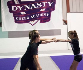 Three teammates as they prepare for a skill. Technique is important in the academy. Without proper technique, 'skills are just thrown'.