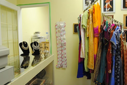 Vibrant costumes and jewellery are all props for BollyFuze shows. Awards, certificates and photos are posted up, displaying BollyFuze's achievements.