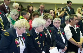 Veterans bow their heads for the two minutes of silence on Nov. 10.