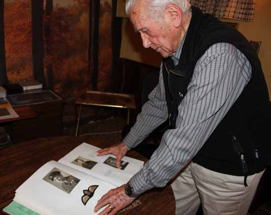 Viewing a personal photo album, veteran pilot William Salo remembers Second World War flying moments.