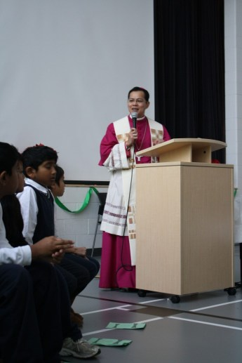 Bishop Nguyen blesses those in attendance at Blessed Pier Giorgio Frassati.