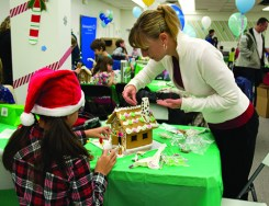 Alejandra Lee, left, and Deborah Lee at the 11th annual Gingerbread Build organized by Habitat for Humanity.