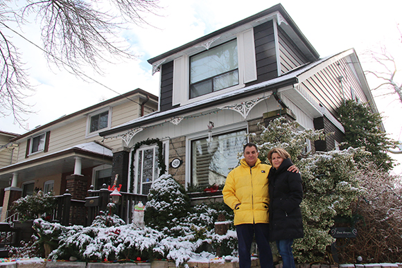Although winter doesn't do it justice, Lorenzo and Josie Ferrara pose with their prize-winning garden.