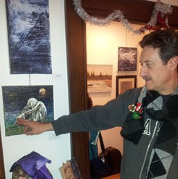 Artist Raymond Dutrisac explains to viewers how he completed his painting.