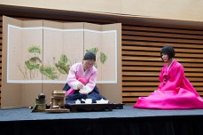 Sun Choi, left, pours hot water into a teapot as Hye Sook Kim looks on during a demonstration of a Korean tea ceremony during the Toronto Tea Festival.