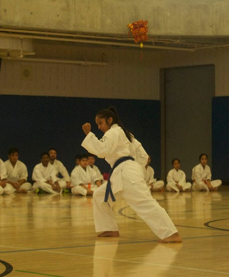Melina, a purple belt in karate, demonstrates traditional karate movement.