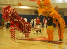 The orange and red dragons dance for the audience.