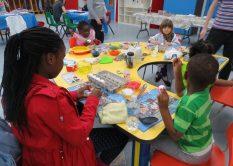 Children decorating their eggs.