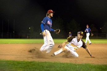 Scott Wells, right, steals third base before scoring to tie the game at 3-3 in the bottom of the fifth.