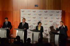 Candidates Tory, Ford and Chow listening to Global TV anchor and moderator Leslie Roberts