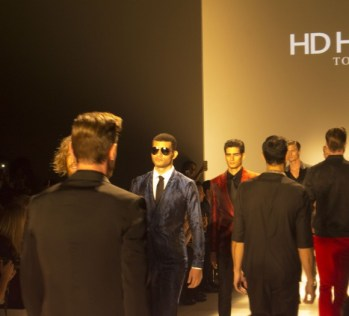 Hd Homme models walk down the runway.