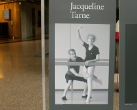 Photo of  71-year-old Jacqueline Tarne doing a ballet pose. The photo is displayed in the lobby of Royal Bank Plaza. An initiative by Photosensitive to bring awareness on the subject of aging Canadians.