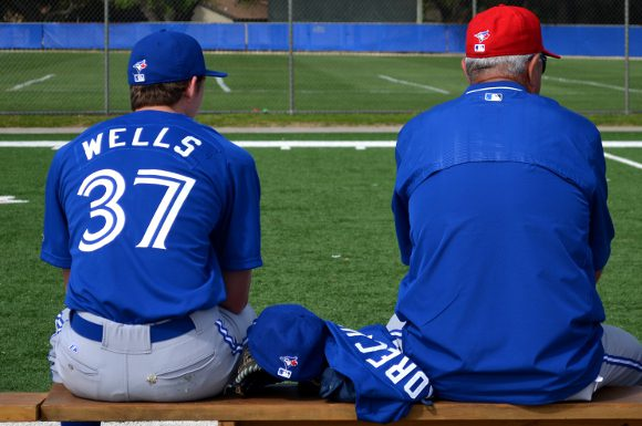 Nick Wells watches his team