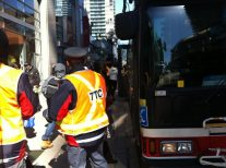 TTC riders board shuttle buses after long wait.