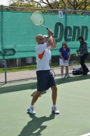 Man catching serves from trainer Branko Stamenic at the grand re-opening of the Thorncliffe Park Tennis Club.