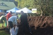 Residents fill up bags with free compost.