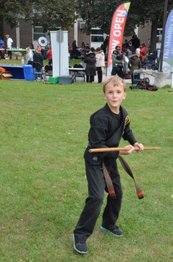 A child shows off his skills at a karate demonstration during the Don Mills Street Festival.