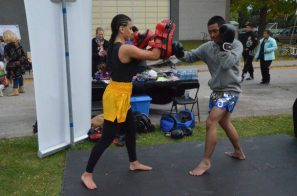 People involved in a kickboxing demonstration at the Don Mills Street Festival.
