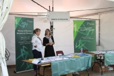 Representatives from the Ministry of Education in conversation at their stall.