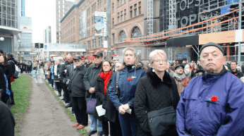 Hundreds of Torontonians gathered on Queen St. around 11 a.m. yesterday to observe the moment of silence.