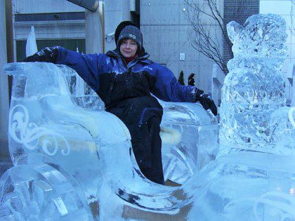 Heidi Bayley poses in a a carriage made of ice, one of the pieces that Ice Culture created for the Bloor-Yorkville Ice Fest in 2007.