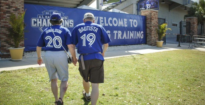 Two Blue Jays fans holding hands