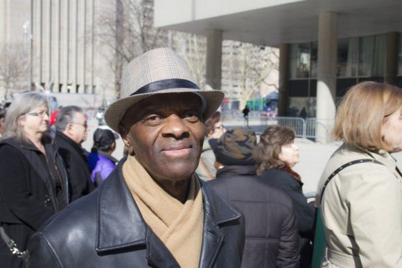"""Joseph Daniel waits to join the procession in front of City Hall. """"He was the politician of the day,"""" Daniel says."""