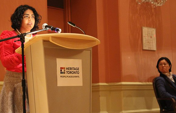 Councillor Kristyn Wong-Tam looks on as Renu Mandhane, Chief Commissioner of the Ontario Human Rights Commission, speaks about the harm of gender specific dress codes in the workplace at the exhibit launch in St. Lawrence Hall on Mar. 8.