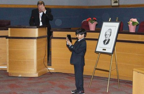 Son of last year's Agnes Macphail award winner takes a picture of his dad and this year's winner, Patrick Rocca.