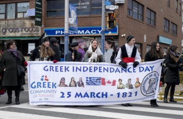 Volunteers dressed in traditional Greek attire celebrate the annual celebration of Greece's independence.